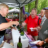 Joe Worzala of West-Whitehill Winery in Moorefield pours a sample for Charlotte, NC resident Greg Riffe, middle, as White Sulphur Springs resident, Richard Leach, far right waits for one Saturday afternoon during the Daniel Vineyards Spring Wine Festival in Crab Orchard. Wine tasting, food and live music were all a part of the festivities, and patrons also had a chance to get a look around the site's picturesque grounds.<br /> Brad Davis/The Register-Herald