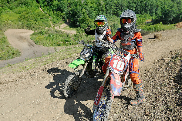 Crab Orchard resident Tyler Hackworth, left, and Daniels resident Torrey Smallwood pose for a quick photo during the final day of Thrills in the Hills at Burning Rock Off-Road Park June 15 near Tams.<br /> Brad Davis/The Register-Herald