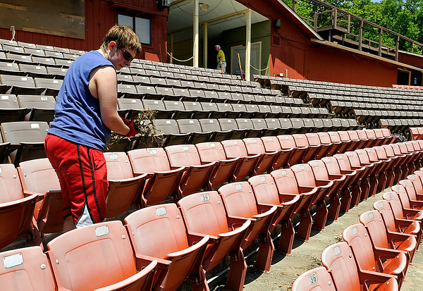 Volunteer and Independence High student Evan Cook scans for loose debris as he pulls weeds at Theatre West Virginia's Cliffside Amphitheatre Sunday afternoon at Grandview State Park. Cook, who took a theatre class at Indy and aspires to one day become a voice actor and animator, was helping out with the preseason cleanup. <br /> Brad Davis/The Register-Herald