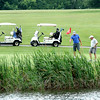 A foursome takes the green of #2 during Thursday's annual YMCA Golf Outing at Grandview Country Club. F. Brian Ferguson/The Register-Herald