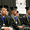 Graduating seniors from Westside High School wait for their turn to collect their diplomas during the school's commencement ceremony June 1 in Clear Fork. <br /> Brad Davis/The Register-Herald