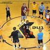 Woodrow Wilson High School Basketball Coach Ron Kidd, center, leads his 1st and 2nd Grade Basketball Camp at the YMCA on Friday morning.  F. Brian Ferguson/The Register-Herald