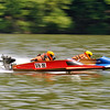 Power boat driver Eric Vanover (#18-H) from Fairfield, Ohio burns up Bluestone Lake as he races side-by-side with his brother Austin during their heat in the 500 Modified class Saturday afternoon during the Travis Pond Memorial Regatta in Hinton. Drivers from all over the country brought their outboard racing boats to Hinton for the Carolina Virginia Racing Association event for a weekend of speed, sun and competition.<br /> Brad Davis/The Register-Herald