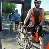 Competitors take to their bikes after finishing up the swimming portion of the Charlie Williamson Triathlon Saturday morning at Glade Springs Resort. <br /> Brad Davis/The Register-Herald