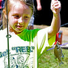 6-year-old Shady Spring resident Braelyn Farrish shows off a Bluegill that she caught during the 23rd Annual Kids Fishing Derby Saturday morning at Little Beaver State Park. Hundreds of kids 14 and under flocked to the lake area at Little Beaver, some of them already angling veterans while others were getting their first fishing experience.<br /> Brad Davis/The Register-Herald