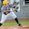 West Virginia Miners #7 squares to bunt against Richmond during Wednesday action in Beckley. F. Brian Ferguson/The Register-Herald