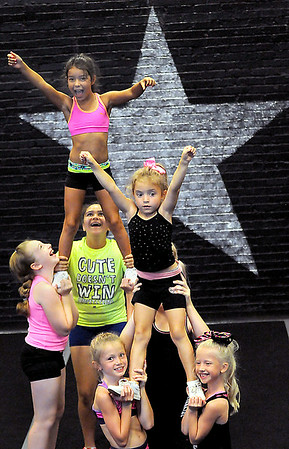 Young stars from the Cheer Magic Cheer camp in Oak Hill go over some of their numbers on Wednesday afternoon. F. Brian Ferguson/The Register-Herald