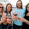 (Left to Right) Kait Creaser, her sister-in-law Kristen Creaser, Steve Redden and Ashley Greer offer a collective cheers as they pose for a quick photo Saturday afternoon during the Daniel Vineyards Spring Wine Festival in Crab Orchard. Wine tasting, food and live music were all a part of the festivities, and patrons also had a chance to get a look around the site's picturesque grounds.<br /> Brad Davis/The Register-Herald