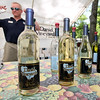 Daniel Vineyards part-time staff member and Beckley firefighter Chris Lanna mans the host winery's table Saturday afternoon during their Spring Wine Festival in Crab Orchard. Lanna, firefighter 1st class at Beckley Station 1, has worked at the local winery for a while now and does pretty much everything around the site's picturesque grounds, from grape harvesting and winemaking to mowing the property.<br /> Brad Davis/The Register-Herald