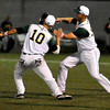 West Virginia 3rd baseman Mike Brosseau (#10) and first baseman Paul Trenhaile celebrate following the Miners' 3-1 win over the Richmond River Rats Friday night at Linda K. Epling Stadium.<br /> Brad Davis/The Register-Herald