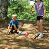 Hickory, North Carolina residents Madelyn Beisler, 8, and her brother Cayden, 6, play a game of murbles June 16 at Pipestem State Park.<br /> Brad Davis/The Register-Herald