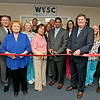 With his mother Surayia (centered in pink) by his side, Dr. Omar Hasan (center in suit) cuts the ceremonial ribbon surrounded by his wife, Dr. Irene Wasylyk (far left), Program Director Alan Kennedy (2nd from left), Dr. John Johnson (far right), and Chamber of Commerce President and CEO Ellen Taylor (3rd from left) and Chairman Matt Stanley (4th from right) during West Virginia Sleep Centers' open house Friday afternoon in Mallard Court. The center offers a full array of services to help people in any matter regarding how one sleeps. Folks with any sleep-related issue ranging from snoring to trouble getting restful sleep can visit the center to see what the problem is.<br /> Brad Davis/The Register-Herald