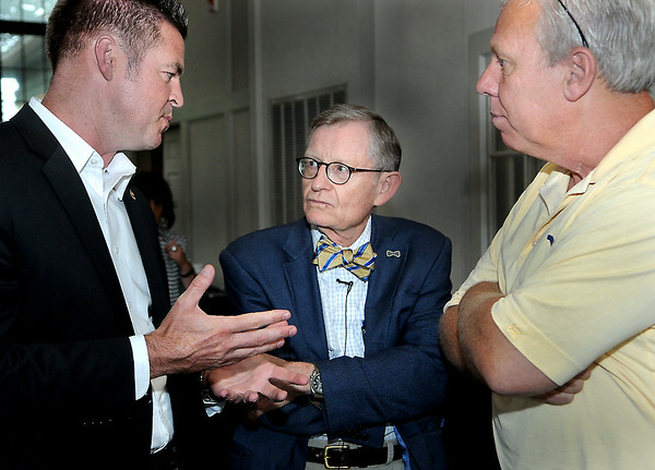 West Virginia Senator Mike Green, left, WVU President Dr. Gee, center, and Steve Antoline, right, exchange ideas during Thursday evening's reception at Black Knight Country Club. F. Brian Ferguson/The Register-Herald