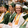Graduating seniors from Wyoming East High School wait for their turn to collect their diplomas during the school's commencement ceremony Sunday evening in New Richmond. <br /> Brad Davis/The Register-Herald