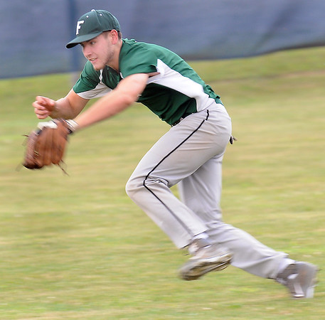 Fayetteville left fielder Caleb Bailes tracks down a hard hit ball for an out during the Pirates Thursday evening game against Princeton. F. Brian Ferguson/The Register-Herald
