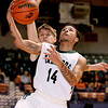Wyoming East's TaRon Ayers scores off another turnover as Summers County's Ashton Garten tries to stop him Tuesday night at the Beckley-Raleigh County Convention Center. <br /> Brad Davis/The Register-Herald