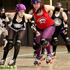 "Beckley Area Derby Dame ""LU C4,"" left, delivers the signal to end a jam after slipping past Five 40 Rollergirl ""Mad Libs"" during the Dames' opening night win Saturday at the Beckley-Raleigh County Convention Center.<br /> Brad Davis/The Register-Herald"
