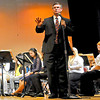 Guest conductor Pat Garrett, Music Education teacher at West Liberty University, introduces the next song that the Southern West Virginia Honors band will play during their performance Saturday afternoon at Woodrow Wilson High School.<br /> Brad Davis/The Register-Herald