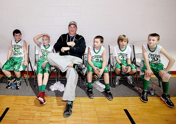 Ceredo-Kenova Wonders assistant coach chills out with players (L to R) Zac Watts, his son Nathan McAnallen, Jace Caldwell, Cade Cole and Jayden Harbert during the halftime break of their 4th grade division game against Beckley White in the Biddy Buddy All-Star Tournament Saturday morning at the YMCA of Southern West Virginia.<br /> Brad Davis/The Register-Herald