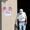 A voter makes his way out of the Fayette County Soldiers and Sailors Memorial Building, in Fayetteville, after casting his ballot during Tuesday's mid-term primary. F. Brian Ferguson/The Register-Herald