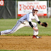 Oak Hill shortstop Ricky Epperly keeps his eye on the ground ball as he dives to stop it against St. Albans Friday evening.<br /> Brad Davis/The Register-Herald
