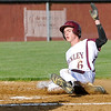 Woodrow Wilson's Jacoby Webb slides into home uncontested to score the Flying Eagles' first run of the game off a sacrifice fly to right field by Chris Metrick against Spring Valley Friday evening in Beckley. It was the first of a five-run first inning for Woodrow Wilson.<br /> Brad Davis/The Register-Herald