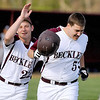Woodrow Wilson's Josh Rakes (right) is congratulated by teammate Chris Metrick after a first inning two-run homer during the Flying Eagles' game against Spring Valley Friday evening. Woodrow got off to a fast start, scoring five runs in the opening frame.<br /> Brad Davis/The Register-Herald