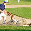 Greenbrier West's Logan Robertson slides into third base before Wildcats infielder Shane Harless can make the tag during sectional action Monday evening in Meadow Bridge.<br /> Brad Davis/The Register-Herald