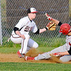 St. Albans' Adam Bowen slides into third base as Oak Hill's Joey Lokant turns to try and make the tag Friday evening. Bowen would be safe on the play and went on to score later in the inning.<br /> Brad Davis/The Register-Herald