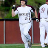 Woodrow Wilson's Josh Rakes celebrates a first inning two-run homer as he rounds third base during the Flying Eagles' game against Spring Valley Friday evening. Woodrow got off to a fast start, scoring five runs in the opening frame.<br /> Brad Davis/The Register-Herald