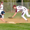 Woodrow Wilson third baseman Matthew Thompson is too late to tag out Spring Valley's Daniel Brandon after oversliding the bag Friday evening in Beckley.<br /> Brad Davis/The Register-Herald