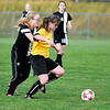West Virginia Chaos U-16 player #11 (LEFT) battles for possession with #3 (yellow, right) Saturday afternoon at the YMCA Soccer Complex.<br /> Brad Davis/The Register-Herald