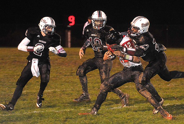 Rick Barbero/The Register-Herald<br /> Deonte Scruggs, 12, of Oak Hill, gets tackled by three  Woodrow Wilson defenders during game at Van Meter Stadium in Beckley Friday evening.
