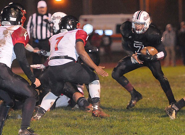 Rick Barbero/The Register-Herald<br /> Antwon Smith, 7, of Oak Hill, left, gets in position to tackle, Brent Osborne, of Woodrow Wilson, during game at Van Meter Stadium in Beckley Friday evening.