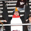 Rick Barbero/The Register-Herald<br /> Emmalee Elkins, left, Bryce Hylton and Emilee Withrow cheer for the Woodrow Wilson Flying Eagles during the game against Oak Hill.