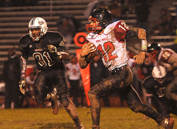 Rick Barbero/The Register-Herald<br /> Deonte Scruggs, 12, of Oak Hill, runs up field for some extra yard against  Woodrow Wilson during game at Van Meter Stadium in Beckley Friday evening.