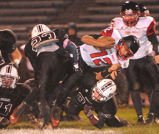 Rick Barbero/The Register-Herald<br /> Deonte Scruggs, 12, of Oak Hill, dives for some extra yards against  Woodrow Wilson during game at Van Meter Stadium in Beckley Friday evening.