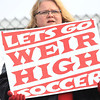 Chris Jackson/The Register-Herald<br /> A Weir fan cheers on their side during their match against Grafton at the state soccer AA/A high school soccer semifinals at Carter Field at the YMCA Paul Cline Memorial Youth Soccer Complex in Beckley on Friday, Nov. 7, 2014.