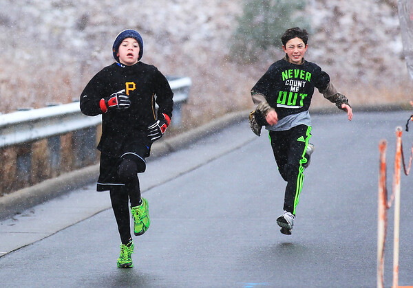 Chris Jackson/The Register-Herald<br /> Runners participate in the 38th Annual YMCA Thanksgiving Day 5-Mile Run and Walk at the YMCA Paul Cline Memorial Youth Sports Complex in Beckley on Thursday, Nov. 27, 2014.