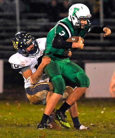 Brad Davis/The Register-Herald<br /> Greenbrier West defensive end Chase Harless sacks Fayetteville quarterback Will Fenton during a game October 31.