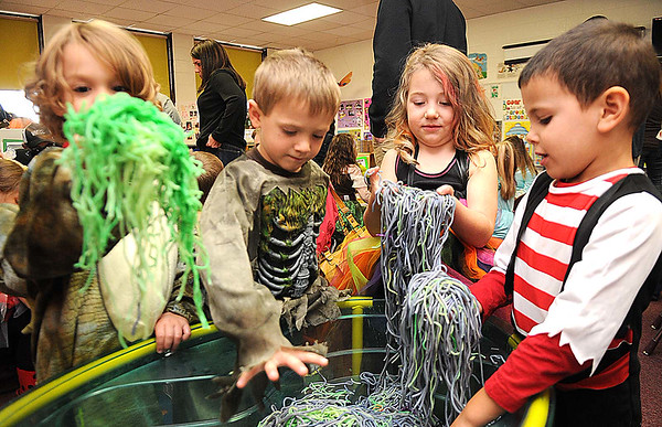Rick Barbero/The Register-herald<br /> Gideon Sotak, left, Bryce Taylor, Mallie Smith and Tryston Ayers Torres, all pre-school children in Mary Beth Garcia's class at Crescent Elementary School play in the Zombie guts booth.