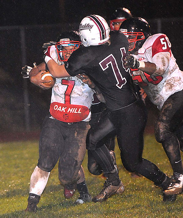 Rick Barbero/The Register-Herald<br /> Antwon Smith, 7, of Oak Hill, legets tackled by Justin Ward, 74, of Woodrow Wilson, during game at Van Meter Stadium in Beckley Friday evening.