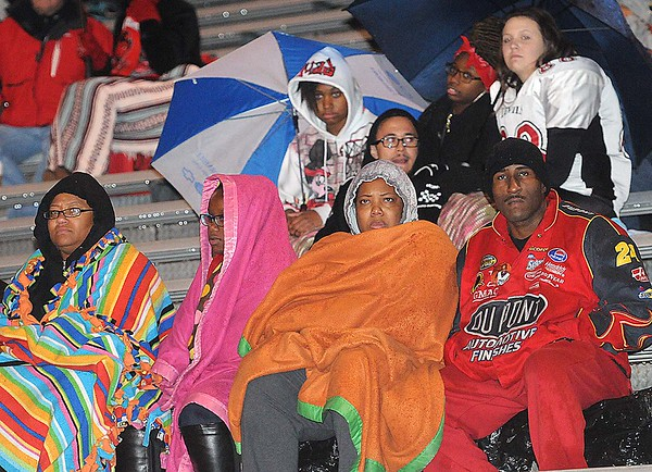 Rick Barbero/The Register-Herald<br /> Oak Hill fans are all bundled up in the cold and rain during a game againt Woodrow Wilson at Van Meter Stadium in Beckley Friday evening.