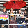 Rick Barbero/The Register-Herald<br /> Four Woodrow Wilson students tucked under a umbrella during the game against Oak Hill at Woodrow Wilson High School.