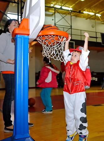 Brad Davis/The Register-Herald<br /> 3-year-old Leelan Ellison plays games during the YMCA of Southern West Virginia's Spooktacular Fun Fest October 25.