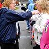 Brad Davis/The Register-Herald<br /> Robin Turner, right, gets a hug from her friend Marsha Basham during the Run For Robin 5K Run/1K Family Walk fundraising event Saturday morning at Hinton's Bellepointe Park.