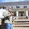 Brad Davis/The Register-Herald<br /> Rocket Boy Roy Lee Cooke describes a few memories of the now dilapidated Coalwood Clubhouse during a trip his native Coalwood Sunday afternoon. Cooke was making his first visit to since 2011, showing a group of enthusiasts around his old stomping ground telling stories of the group's antics and remembering old times. He has a strong desire to see the aging building restored, but there are many hurdles and any project would require a substantially large amount of money.