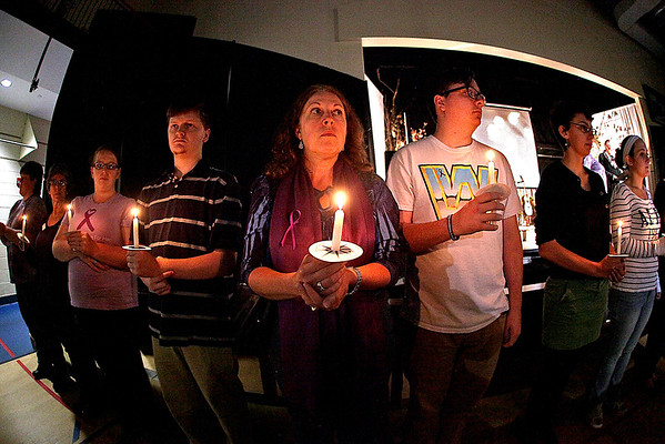 Brad Davis/The Register-Herald<br /> Supporters, victims, survivors and advocates participate in a candlelight vigil and moment of silence during the 24th Women's Resource Center event Saturday night at The Place at United Methodist Temple.