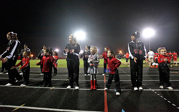Brad Davis/The Register-Herald<br /> Young cheerleaders from youth football leagues around the Oak Hill area get a taste of the Friday night lights as they dance and cheer with the Red Devil squad during their game against Point Pleasant.