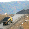 Rick Barbero/The Register-Herald<br /> Truck hauling coal away during a media tour of the Coalfields Expressway construction site.